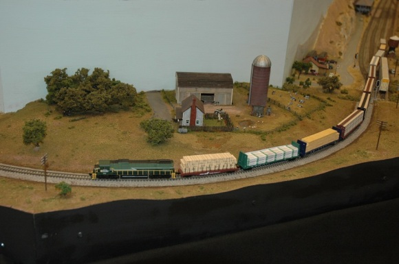 Lumber rolling passed the farm (Photo by Morgan)